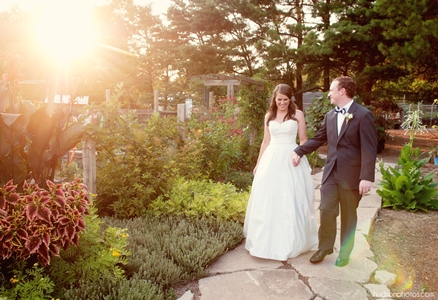 A bride and groom portrait taken outside the Vegetable & Herb Garden