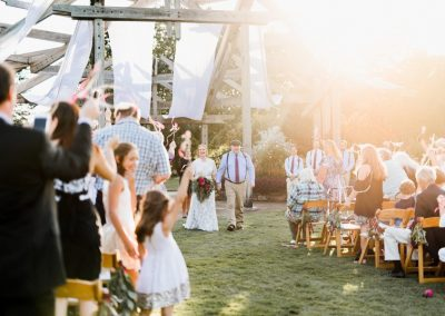 Wedding ceremony on the Great Lawn using drapes on the arbor