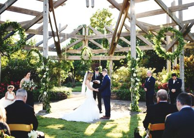 Traditional wedding ceremony under the arbor